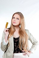 Happy young woman holding a golden credit card