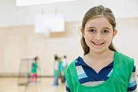 Portrait of elementary student in gymnasium.