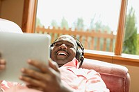 African American man with headphones enjoying pc tablet