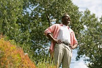 African American man standing in meadow