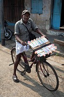 A lottery ticket seller on his bicycle in Kochi Cochin, Kerala, India, Asia