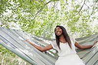 Young adult woman swinging in hammock