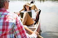 Middle-aged couple out for a canoe ride (thumbnail)