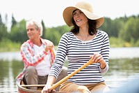 Mature couple canoeing on lake
