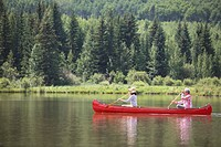 Mature couple canoeing together in the countryside