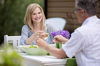 Middle_aged couple enjoying an outdoor meal together.