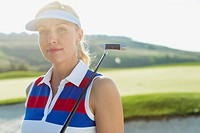 Pretty, female golfer with putter