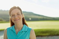 Portrait of pretty, mid_adult female golfer