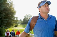 Golfer gazing off to next hole challenge