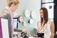 Woman paying in clothing store