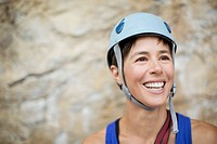 Pretty, female rock climber wearing helmet