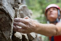 Focus on hand of middle_aged female rock climber