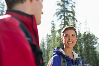 Pretty, female hiker having conversation with fellow hiker