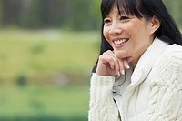 Pretty, middle_aged Asian woman in the country