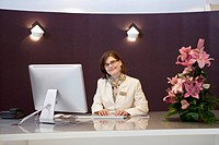 Portrait of receptionist in hotel (thumbnail)
