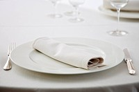 Close up of elegant place setting in restaurant