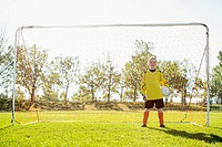 Young female goalkeeper on girls soccer team