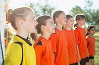 Young female soccer players lined up
