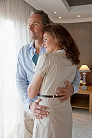 Couple embracing in hotel room