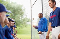 Coaches talking with boys baseball team (thumbnail)