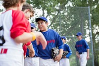 Boys baseball team shaking hands after ball game (thumbnail)