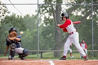 Young ball player watching pitch go past the plate (thumbnail)