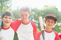 Three members of boys baseball team standing together (thumbnail)