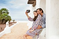 Couple taking pictures during vacations
