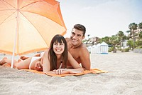 Young couple resting on beach