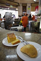 Sopa paraguaya cornbread with cheese and onion and empanada in Lido Bar, Asuncion, Paraguay, South America