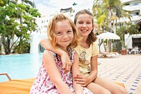 Portrait of two girls 6-9 at poolside (thumbnail)