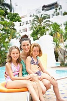 Portrait of mother with daughters 6_9 at poolside