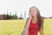 Pretty teenage girl on smart phone in park (thumbnail)