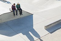 View from above of two teenage boys at skate_park