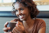 Pretty African American woman enjoying a cup of coffee.