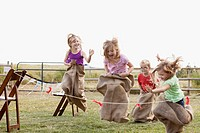 Cousins competing in potato sack race.