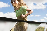 Young girl participating in a potato sack race (thumbnail)