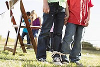 Kids getting ready to compete in a 3 legged race (thumbnail)
