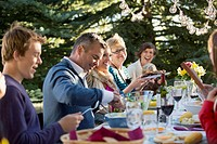 Family enjoying an outdoor meal together