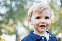 Portrait of cute 2 year old boy with brown eyes