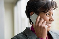 Profile of African American businesswoman on cell phone