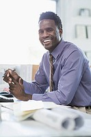 Mid_adult African American businessman at desk