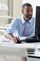 African American man at desktop computer in office