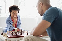 Father and son enjoying a game of chess