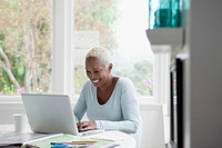 Middle_aged woman browsing on laptop