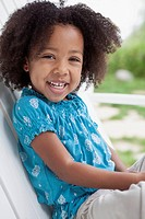 Cute African American preschool_age girl smiling outdoors