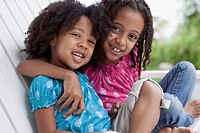 Portrait of cute, African American sisters