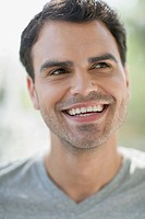 Attractive mid_adult Latin American man smiling.