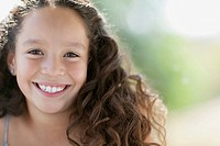 Portrait of pretty elementary_aged girl with long wavy hair