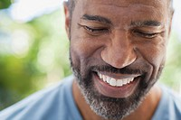 Handsome African American man smiling with eyes closed